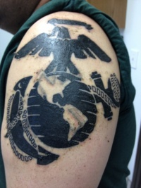 Black usmc military tattoo on shoulder