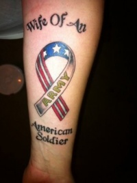 Coloured american soldier tattoo on arm